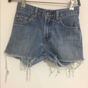 Levi's denim shorts with fringes on the bottom.
